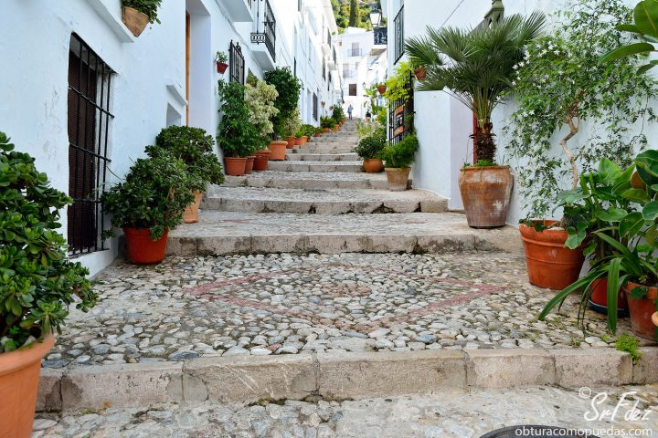 A typical pittoresk stairs street in the white village of Frigiliana